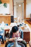 Young asian woman Craftsman Artist Pottery Skill Workshop Concept, woman woking on pottery job royalty free stock image
