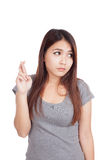 Young Asian woman cross her fingers look away Stock Photography