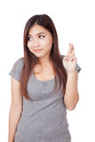 Young Asian woman cross her fingers look away Royalty Free Stock Image