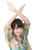 Young asian woman crossed hands overhead Royalty Free Stock Photography