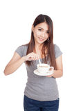 Young Asian woman with cup of coffee. Isolated on white background Stock Photography