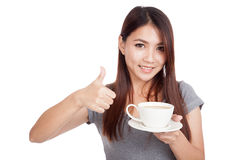 Young Asian woman with cup of coffee. Isolated on white background Stock Image
