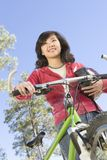 Young Asian Woman With Cycling Helmet And Mountain Bike Royalty Free Stock Photos