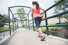 Young asian woman doing excercise outdoor in a park, jogging Stock Photography