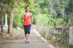 Young asian woman doing excercise outdoor in a park, jogging Royalty Free Stock Images