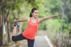 Young asian woman doing excercise outdoor in a park, stretching Stock Image