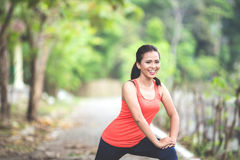 Young asian woman doing excercise outdoor in a park, stretching Stock Images