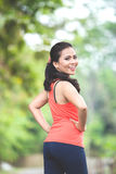 Young asian woman doing excercise outdoor in a park, stretching Royalty Free Stock Photo