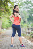 Young asian woman doing excercise outdoor in a park, stretching Royalty Free Stock Images
