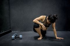 Young Asian woman doing exercise in fitness gym Stock Photos
