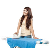 Young asian woman doing the laundry Royalty Free Stock Photo