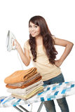 Young asian woman doing the laundry Royalty Free Stock Image