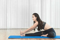 Young Asian woman doing yoga. Stock Photo