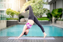 Young Asian woman doing yoga exercise Stock Images