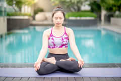 Young Asian woman doing yoga exercise Stock Image