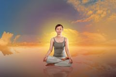 Young asian woman doing yoga Royalty Free Stock Image