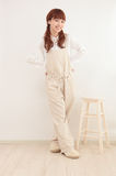 Young Asian woman dressed in overalls Stock Photography