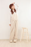 Young Asian woman dressed in overalls Royalty Free Stock Photo