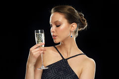 Young asian woman drinking champagne at party Royalty Free Stock Photo