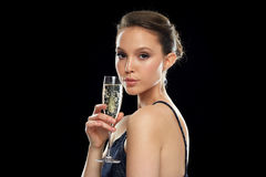 Young asian woman drinking champagne at party Stock Images