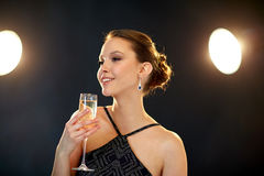 Young asian woman drinking champagne at party Royalty Free Stock Image