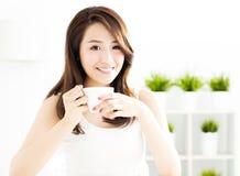 Young asian woman drinking coffee. Beautiful young asian woman drinking coffee Stock Image