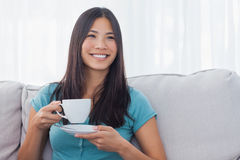 Young asian woman drinking cup of tea Stock Photos