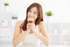 Young asian woman drinking hot tea Royalty Free Stock Photos