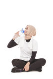 Young asian woman drinking mineral water during break after work Stock Photo