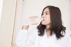 Young asian woman drinking water Stock Photo