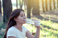 Young asian woman drinking water Royalty Free Stock Photo