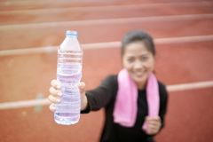 Young asian woman drinking water Royalty Free Stock Photos