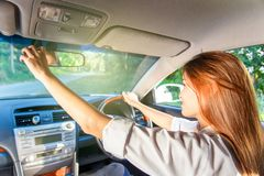 Young asian woman driver adjusting her rearview mirror in the car. Thailand Stock Images
