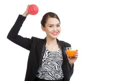 Young Asian woman with dumbbell drink orange juice Royalty Free Stock Photography