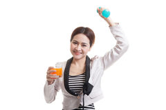 Young Asian woman with dumbbell drink orange juice. Stock Photos
