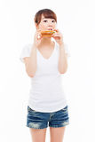 Young Asian woman eat sandwhich. Stock Photography
