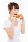 Young Asian woman eat sandwhich. Royalty Free Stock Image