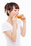 Young Asian woman eat sandwhich. Stock Photos