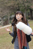 Young Asian woman eating cotton candy Stock Photos