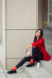 Young asian woman eating fast food outdoors Royalty Free Stock Images