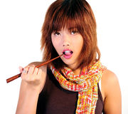 Young asian woman eating sushi Stock Photo