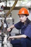 Young asian woman engineer set up and testing machine stock images