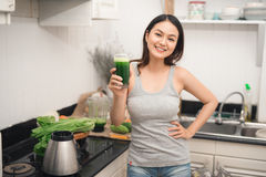 Young asian woman enjoy healthy vegetarian smoothie for weight l. Oss and detox Stock Photography