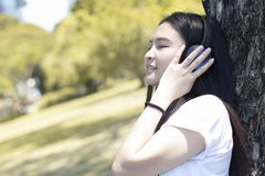 Young Asian woman is enjoy lifestyle and listening music royalty free stock photos