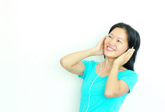 Young asian woman enjoy music Stock Images