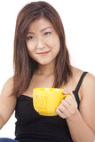 Young Asian woman enjoying a cup of coffee Royalty Free Stock Photography