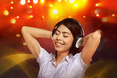 Young asian woman enjoying the music with headphone Royalty Free Stock Images