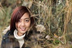 Young Asian woman enjoying nature Stock Photo