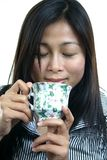 YOUNG ASIAN WOMAN ENJOYING TEA 4 Stock Photography