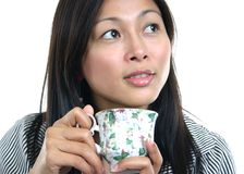 YOUNG ASIAN WOMAN ENJOYING TEA 4 Royalty Free Stock Photography